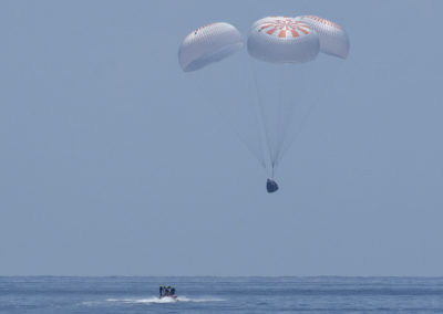 The SpaceX Crew Dragon Endeavour spacecraft is seen as it lands with NASA astronauts Robert Behnken and Douglas Hurley onboard in the Gulf of Mexico off the coast of Pensacola, Florida, Sunday, Aug. 2, 2020. The Demo-2 test flight for NASA's Commercial Crew Program was the first to deliver astronauts to the International Space Station and return them safely to Earth onboard a commercially built and operated spacecraft. Behnken and Hurley returned after spending 64 days in space. Photo Credit: (NASA/Bill Ingalls)